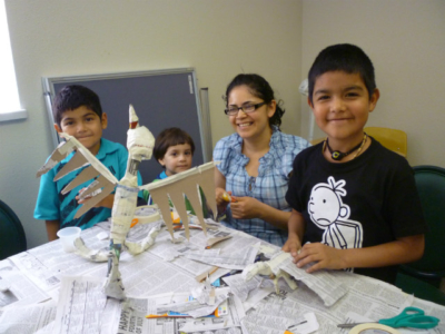kids making papier mache creatures