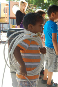 summer art camp - boy holding the rope