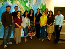DTL staff in front of world map - small