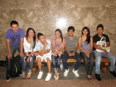 Pasos students gathered on the bench