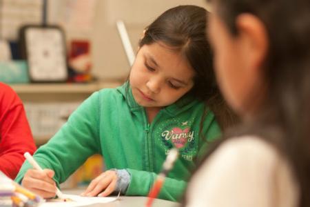 Girl in green, writing
