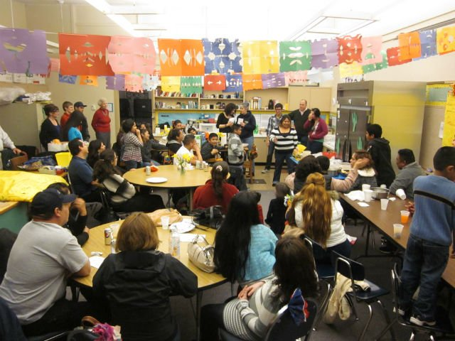 Families gather in the classroom