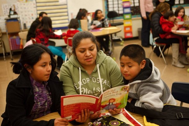 Mom and kids reading together