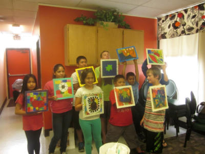 the kids show off their paintings