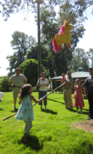 girl trying to burst the pinata
